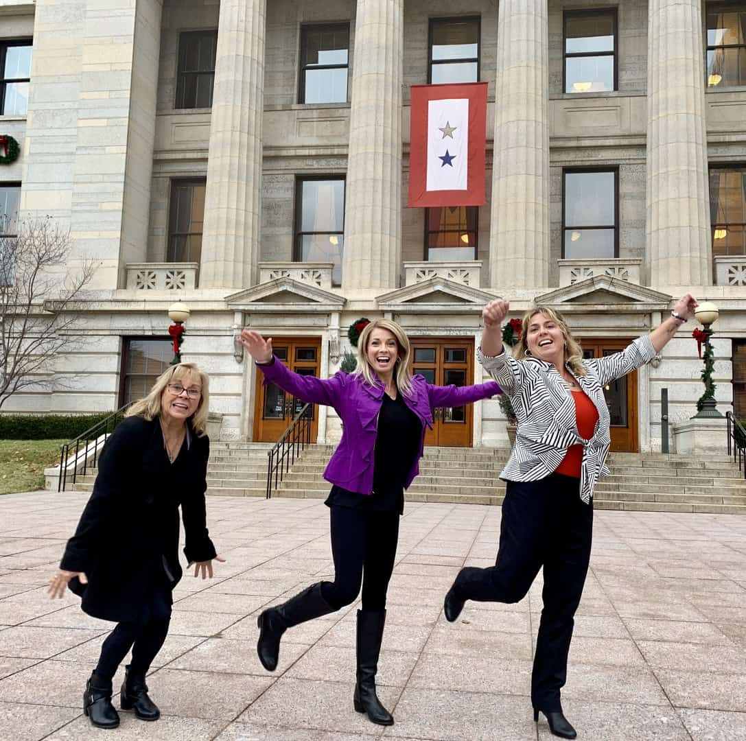 Sierah's grandmother, mother and aunt jumping for joy at the passing of Sierah's law, in front of the Ohio congress